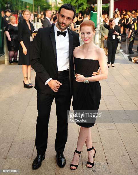 Riccardo Tisci and Jessica Chastain arrive at the 2013 CFDA Fashion Awards at Alice Tully Hall on June 3 2013 in New York New York