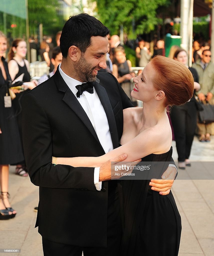 Riccardo Tisci and Jessica Chastain arrive at the 2013 CFDA Fashion Awards at Alice Tully Hall on June 3, 2013 in New York, New York.