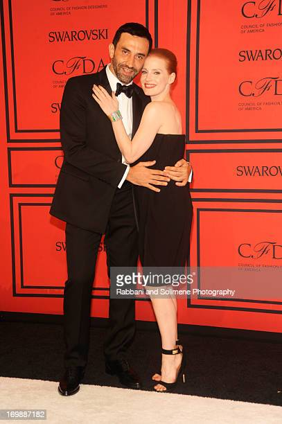 Riccardo Tisci and Jessica Chastain attends 2013 CFDA Fashion Awards at Alice Tully Hall on June 3 2013 in New York City