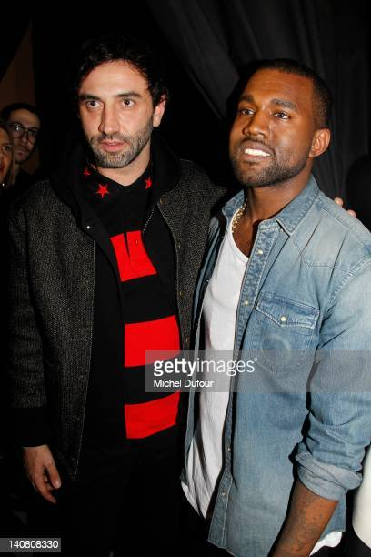 Riccardo Tisci and Kanye West attend the Kanye West ReadyToWear Fall/Winter 2012 show as part of Paris Fashion Week at Halle Freyssinet on March 6...