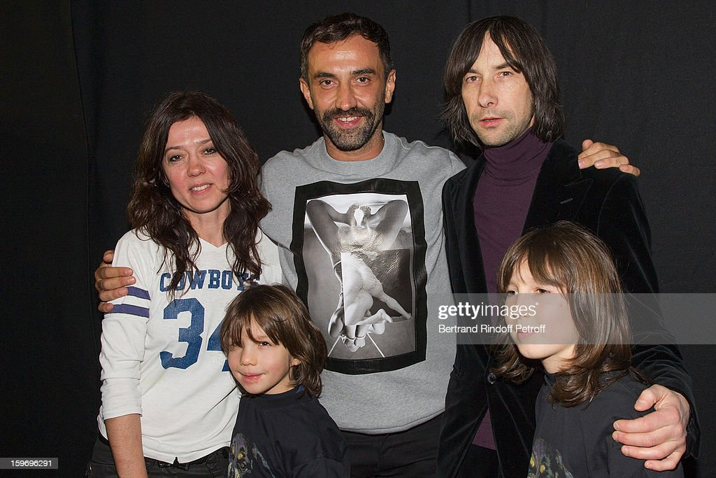 Riccardo Tisci (C), Bobby Gillespie (R), Gillespie's sons Wolf (R) and Lux, and guest (L) attend the Givenchy Men Autumn / Winter 2013 show as part of Paris Fashion Week on January 18, 2013 in Paris, France.