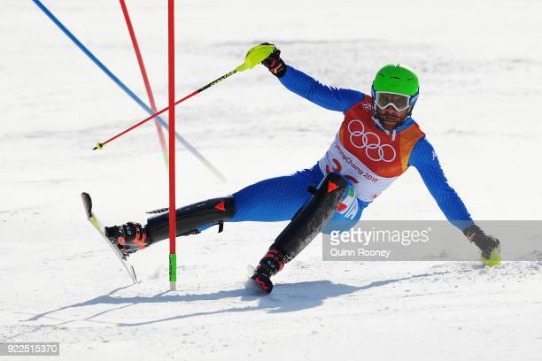 Riccardo Tonetti of Italy crashes during the Men's Slalom on day 13 of the PyeongChang 2018 Winter Olympic Games at Yongpyong Alpine Centre on...