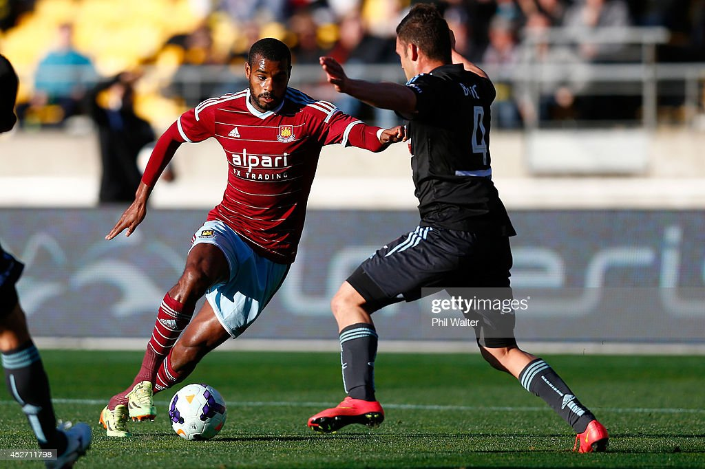 Riccardo Vazte of West Ham is tackled by Pedj Bojic of Sydney FC during the Football United New Zealand Tour match between Sydney FC and West Ham United at Westpac Stadium on July 26, 2014 in Wellington, New Zealand.