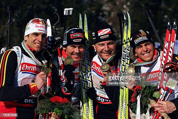 Ricco Gross Michael Roesch Sven Fischer and Michael Greis of Germany celebrate winning the bronze medal of the Men's 4 x 75 Relay in the Biathlon...