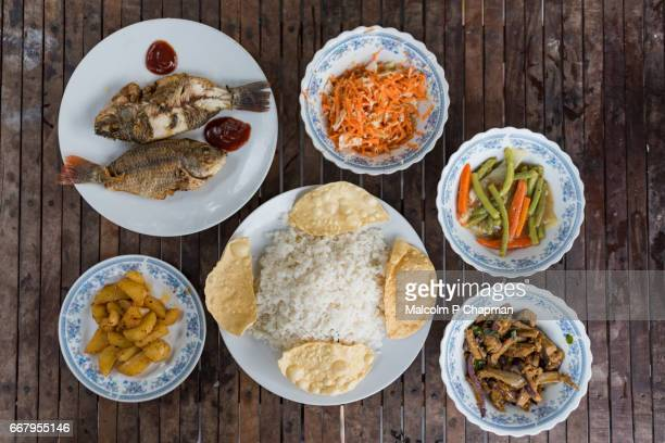 rice and curry is the national sri lankan dish and comprises of a selection of small dishes with rice - sri lanka stock pictures, royalty-free photos & images