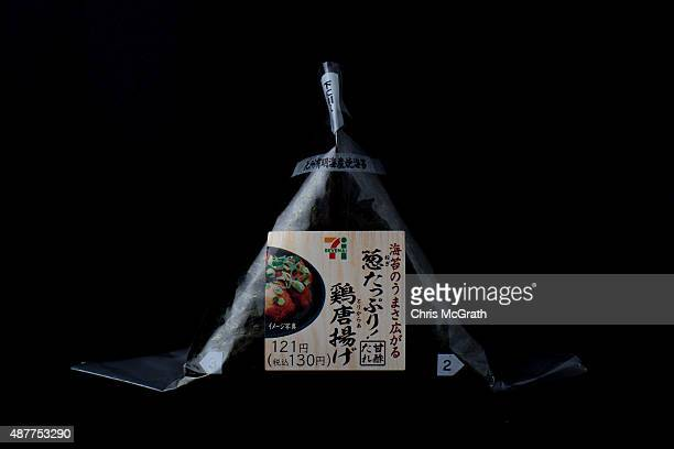 """Rice ball or """"onigiri"""" containing fried chicken from a convenience store or """"konbini"""" is pictured on September 10, 2015 in Tokyo, Japan. Japan's..."""
