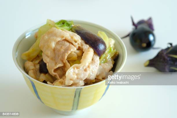 Rice bowl. Eggplant and Miso Stir-fry on top of the rice in bowl.