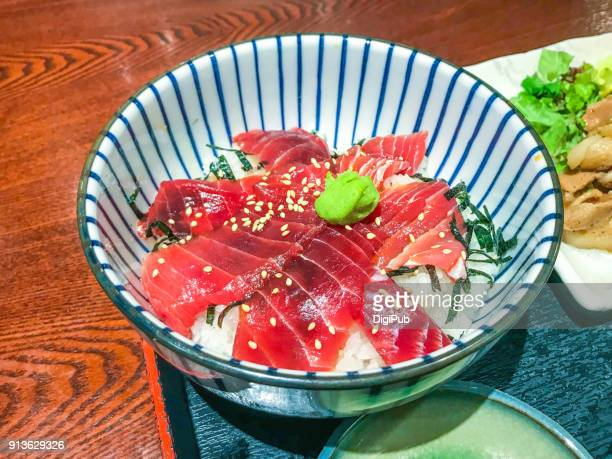 rice bowl topped with soy-marinated tuna sashimi. - wasabi stock pictures, royalty-free photos & images
