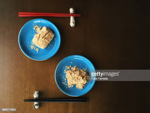 rice cakes with roasted soybean flour - kinako stock pictures, royalty-free photos & images