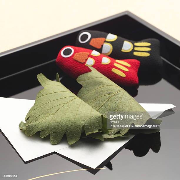 rice cakes wrapped in leaves and carp dolls for children's day - 鯉のぼり ストックフォトと画像