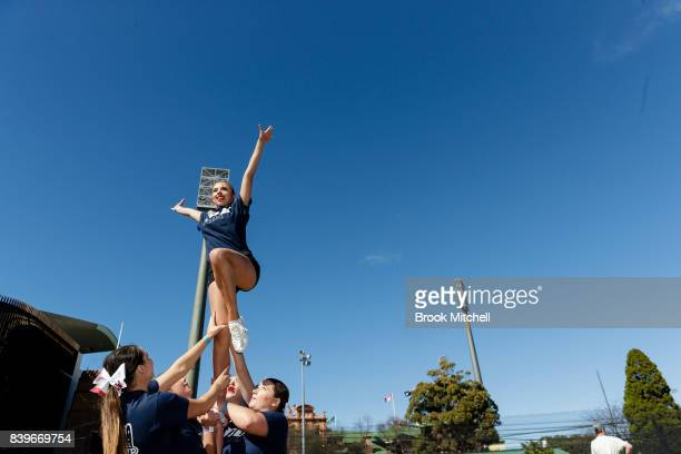 A rice cheerleader performs before the College Football Sydney Cup match between Stanford University and Rice University at Allianz Stadium on August...