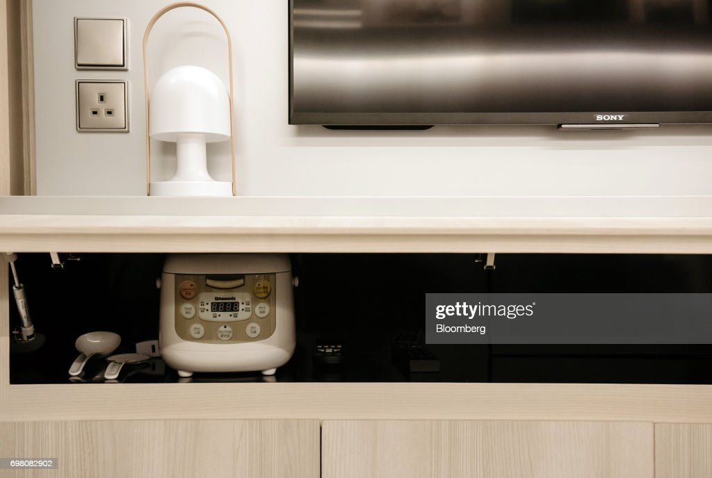 A Rice Cooker Sits Inside A Cabinet At A Seven Victory Avenue  Micro Apartment Show