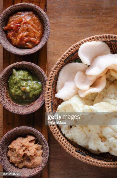 rice crackers and dips - chutney stock pictures, royalty-free photos & images