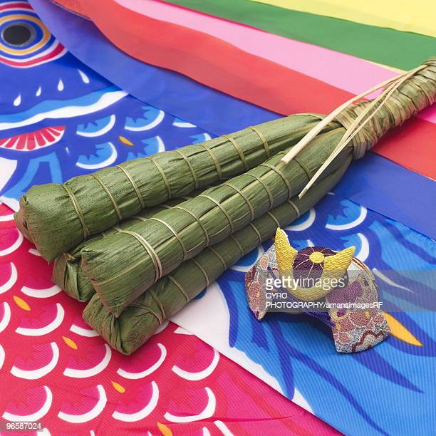 rice dumplings wrapped in bamboo leaves on a carp streamer - 鯉のぼり ストックフォトと画像