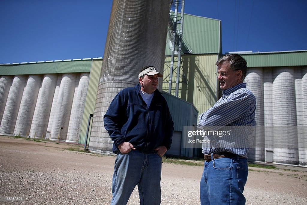 Rice farmers Ronald Gertson (R) and Blair Pfardrescher talk about the rice business as they stand next to a closed rice storage facility on March 12, 2014 in Lissie, Texas. Due to a severe drought afflicting the region, the facility closed as rice farmers do not have enough water to grow a sufficient crop. Recently the Texas Commission on Environmental Quality agreed to cut off water deliveries to most rice farmers in the Lower Colorado River Basin for the third straight year as the lakes in central Texas are only 38 percent full.