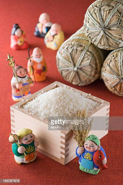 Rice in Measuring Cup and Seven Lucky Gods and Rice Bale