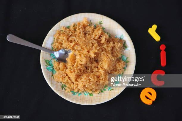 Rice in plate with spoon