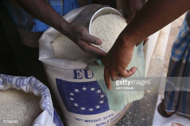 Rice is distributed as relief aid to internally displaced ethnic Tamils at a center in Valaichenai in governmentheld territory of northeastern Sri...