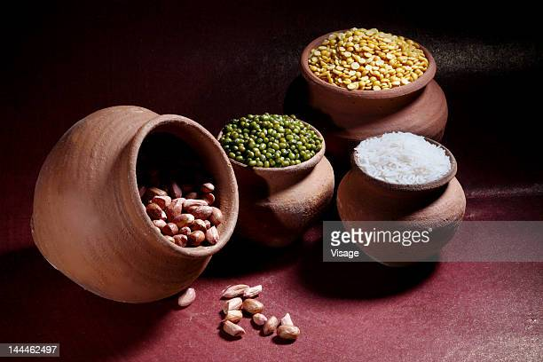 Rice, nuts and pulses in earthen pots