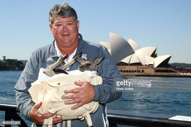 Rice Owls head coach David Bailiff poses with Archer the kangaroo during the College Football Sydney Cup between Stanford University and Rice...