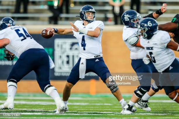 Rice Owls quarterback Mike Collins looks downfield for an open receiver during the game between the North Texas Mean Green and the Rice Owls on...