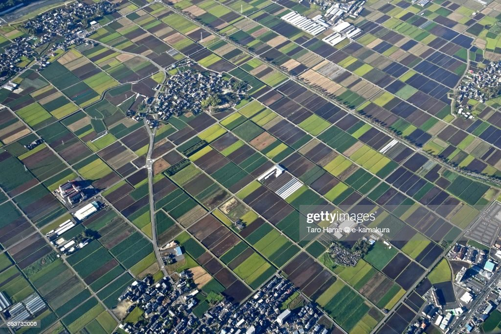 Rice paddy and fields in Mashiki town in Kumamoto prefecture daytime aerial view from airplane : ストックフォト