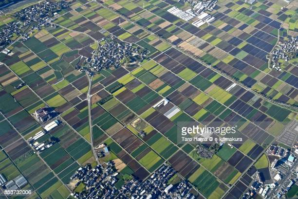Rice paddy and fields in Mashiki town in Kumamoto prefecture daytime aerial view from airplane
