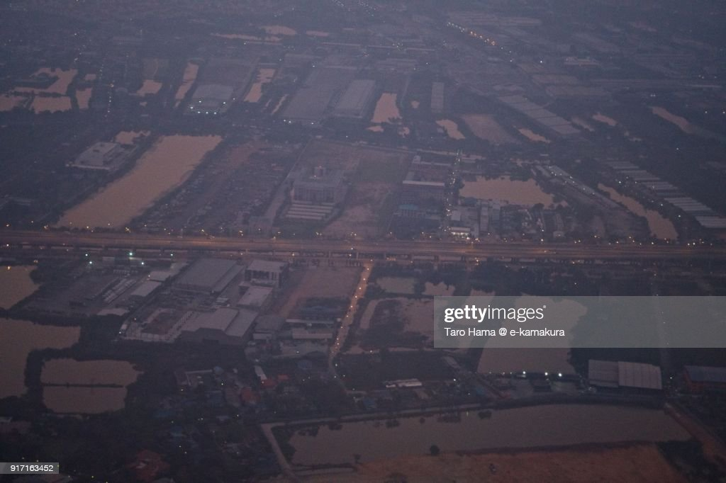 Rice paddy and road suburb of Bangkok city in Samut Prakan in Thailand aerial view from airplane in the morning : ストックフォト