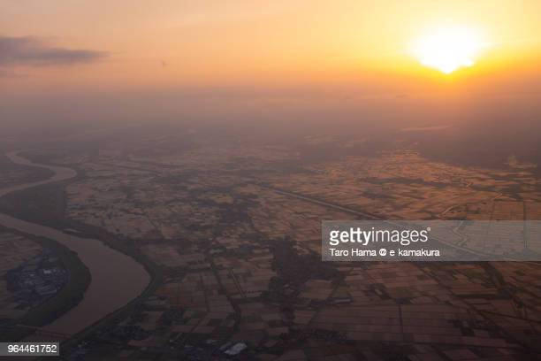 rice paddy and tone river in narita city and kawachi town in japan sunset time aerial view from airplane - 成田市 ストックフォトと画像