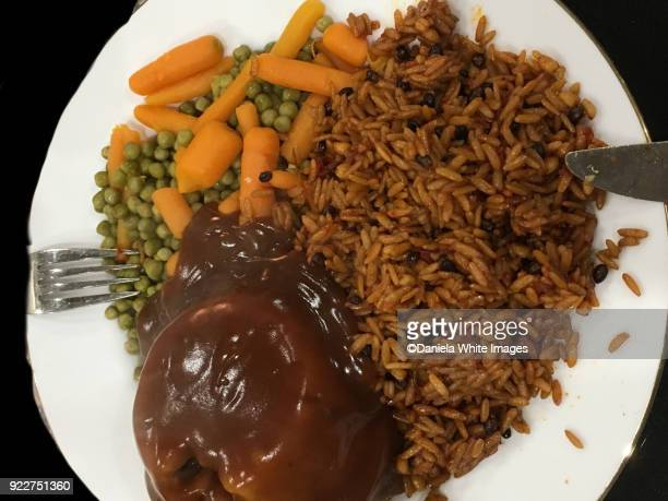 Rice, peas and carrots and steak pie with gravy