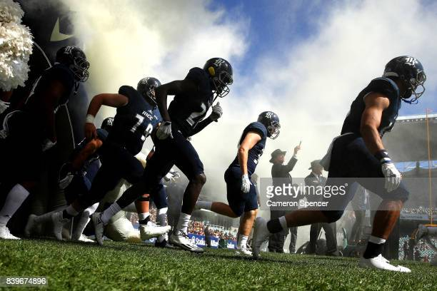Rice players run onto the field during the College Football Sydney Cup match between Stanford University and Rice University at Allianz Stadium on...