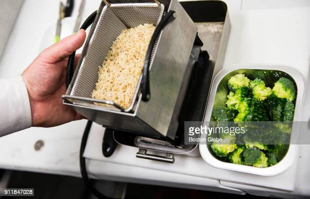 Rice prepared in the Suvie a sous vide cooking device sits in the boiling section of the device at the company's office in Cambridge MA on Jan 23...