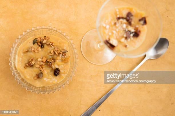 Rice pudding dessert with cranberry granola garnish.