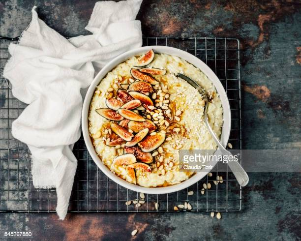 rice pudding with pine nuts, fresh figs and maple syrup - cooling rack stock photos and pictures