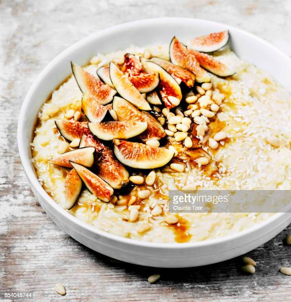 Rice pudding with pine nuts, fresh figs and maple syrup