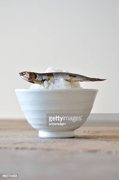 A rice putted on dried sardine