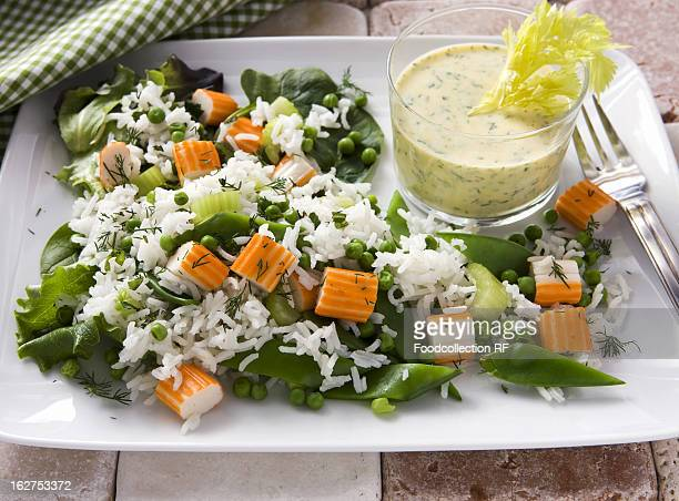 Rice salad with surimi, mange tout and yogurt dip