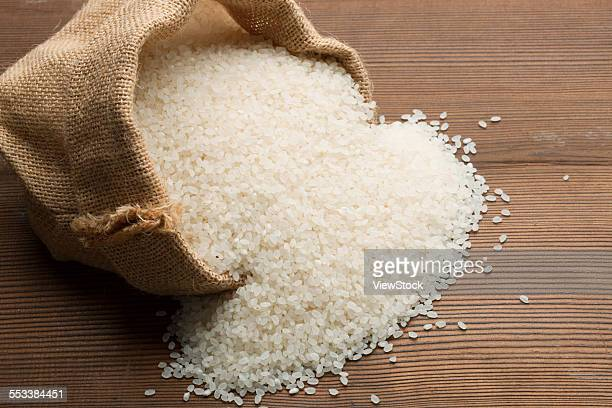 Rice scattered out of the sack