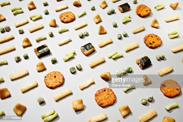 "rice snacks in a grid pattern - ""shana novak"" stock pictures, royalty-free photos & images"