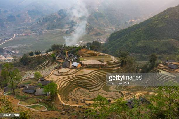 rice terrace paddies with smoke in harvest time, sa pa, lao cai, north vietnam - sa pa stock photos and pictures