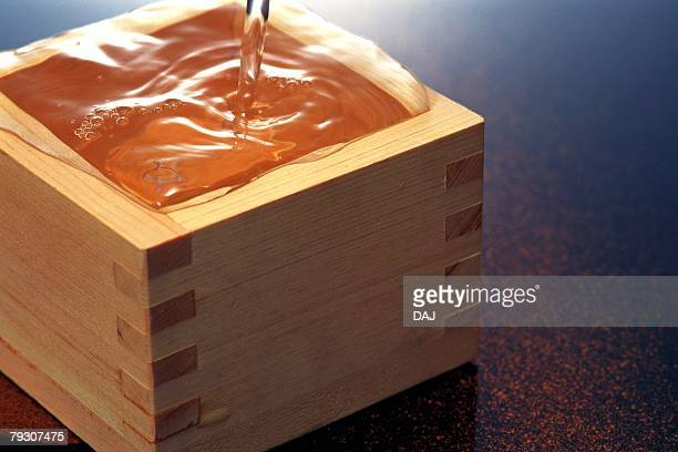 Rice wine poured into a square container of wood, Close Up, High Angle View