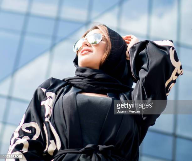 rich arab woman on city street - shawl stock pictures, royalty-free photos & images