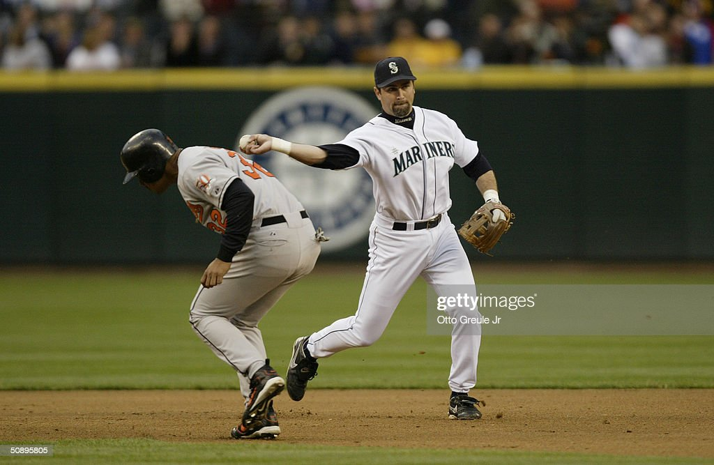 Rich Aurilia #35 of the Seattle Mariners throws to first base against the Baltimore Orioles during their game on May 19, 2004 at Safeco Field in Seattle, Washington. The Orioles won 5-2.
