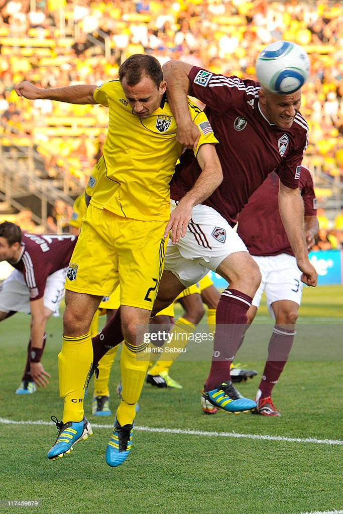 Rich Balchan #2 of the Columbus Crew and Conor Casey #9 of the Colorado Rapids battle for control of the ball in the first half off a Colorado corner kick on June 26, 2011 at Crew Stadium in Columbus, Ohio.