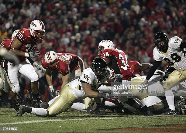 Rich Belton of the Wake Forest Demon Deacons crosses for the game clinching touchdown against the Maryland Terrapins at Chevy Chase Bank Field on...