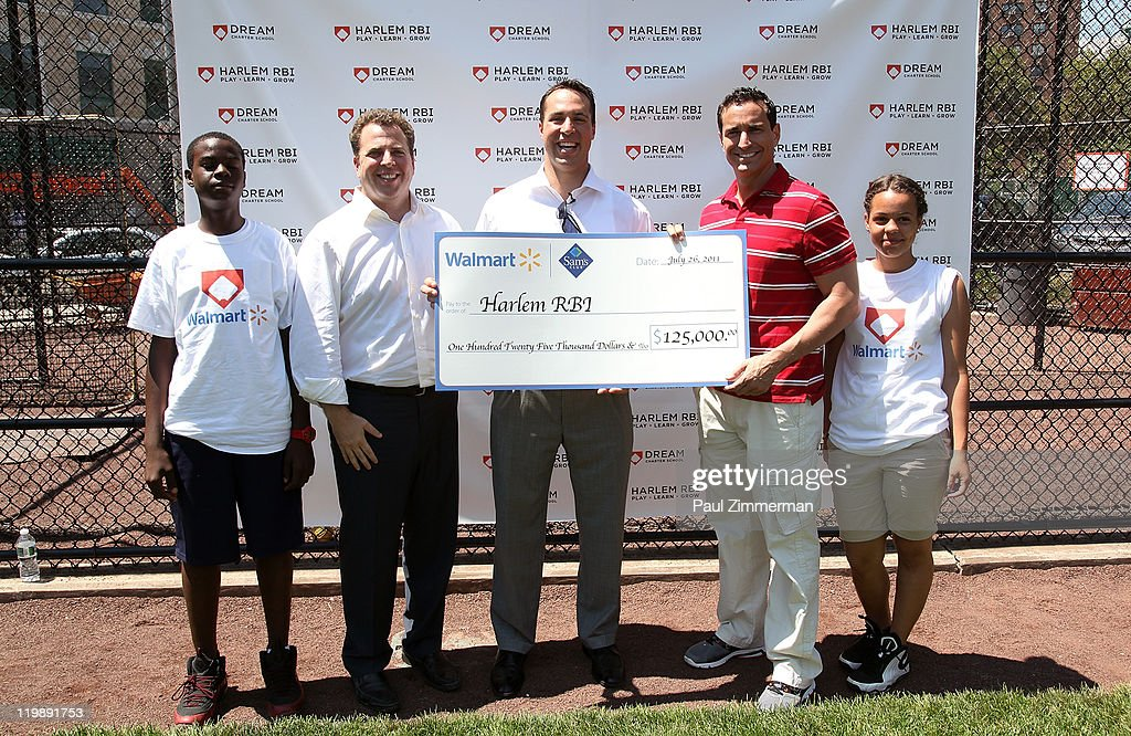 Rich Berlin, Mark Teixeira and Philipe Serghini attend the announcement of Walmart's donation to the Harlem RBI Youth Employment Program and DREAM Charter School at the Field of Dreams on July 26, 2011 in New York City.