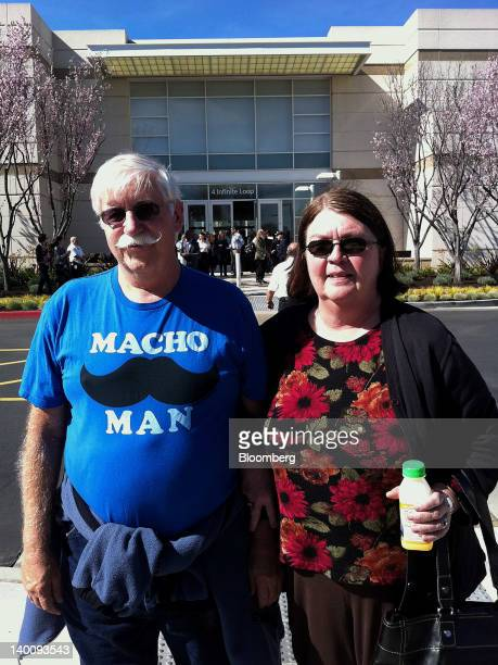 Rich Bleyle left and his wife Mary Bleyle stand for a photo outside Apple Inc headquarters following the annual shareholders meeting in Cupertino...