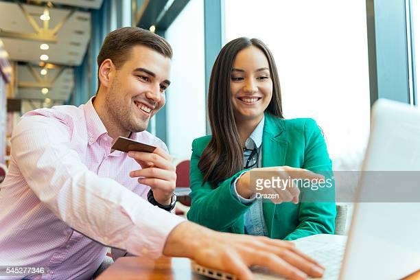 Rich boyfriend buying gifts for his girlfriend online