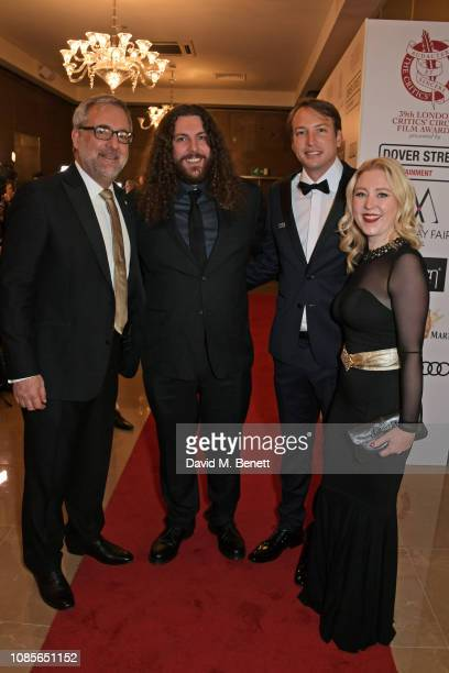 Rich Cline, Chair of the Critics' Circle Film Awards, Adam Gough, Nicolas Celis and Anna Smith, President of the Critics' Circle, attend The 39th...