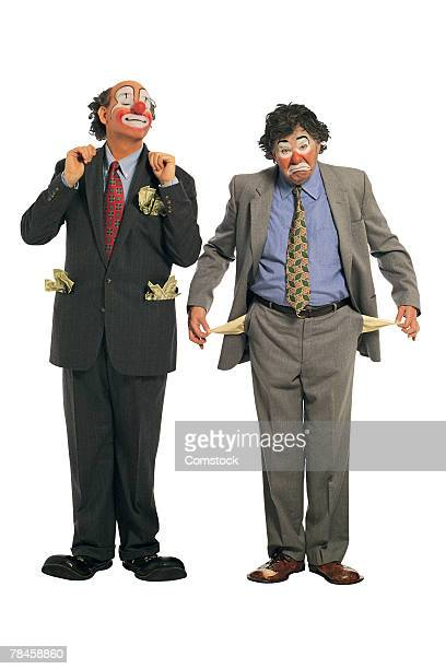 rich clown and poor hobo - sad clown stock photos and pictures